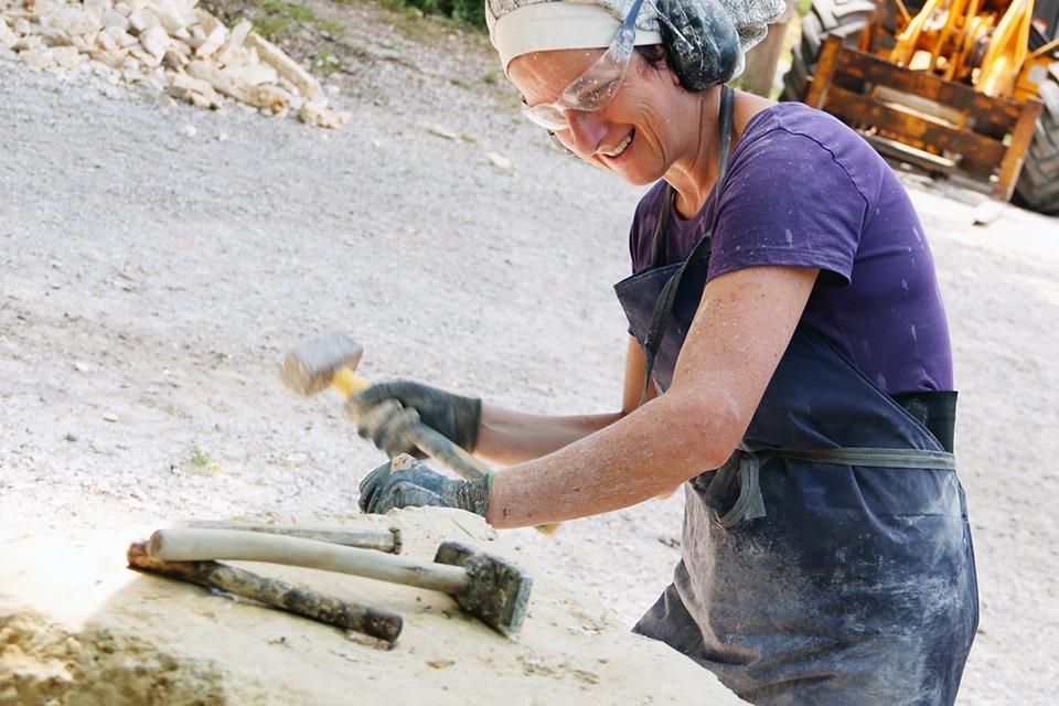 Emanuela Camacci working on a stone sculpture