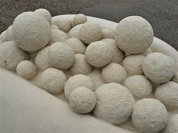 Stone sculpture PAPAYA detail of the small spheres