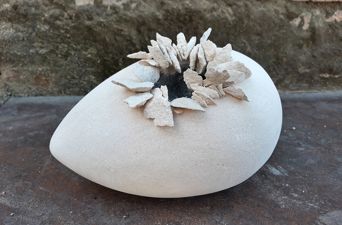 Sculpture in stone on the thema Egg by Emanuela Camacci