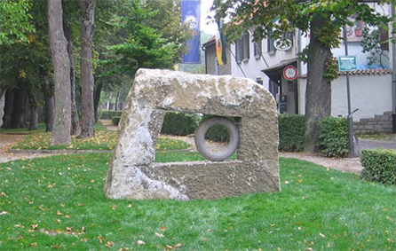Sculpture in sanstone carved with a rough surface and organic form
